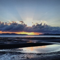 Sunrise with 'God rays' in Kawau Bay.